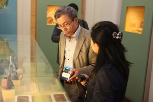 Chen, Chi-Ming and Ding Ning examine a display at the National Museum of Brazil